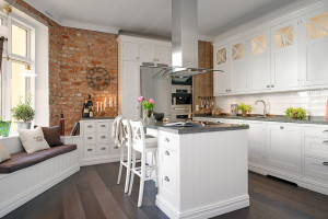Modern White Kitchen with Brick Wall