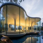 Minimalist Curved Glass Cloud of Luster Wedding Chapel in Japan