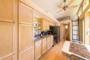 Tiny House Kitchen with Oak Cabinet and Quartz Countertop