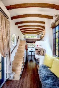 Tiny House with Staircase and Arched Wood Beams