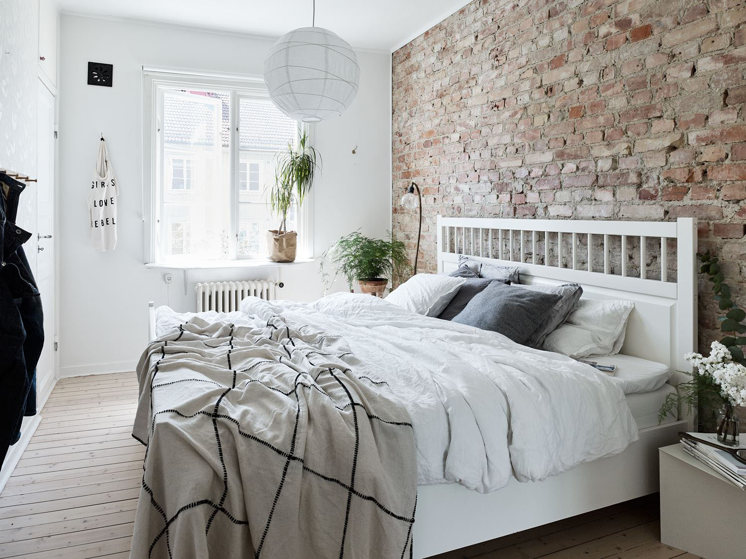 Charming Bedroom with Brick Wall