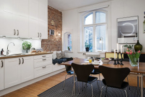 White Modern Kitchen with Rustic Brick Wall