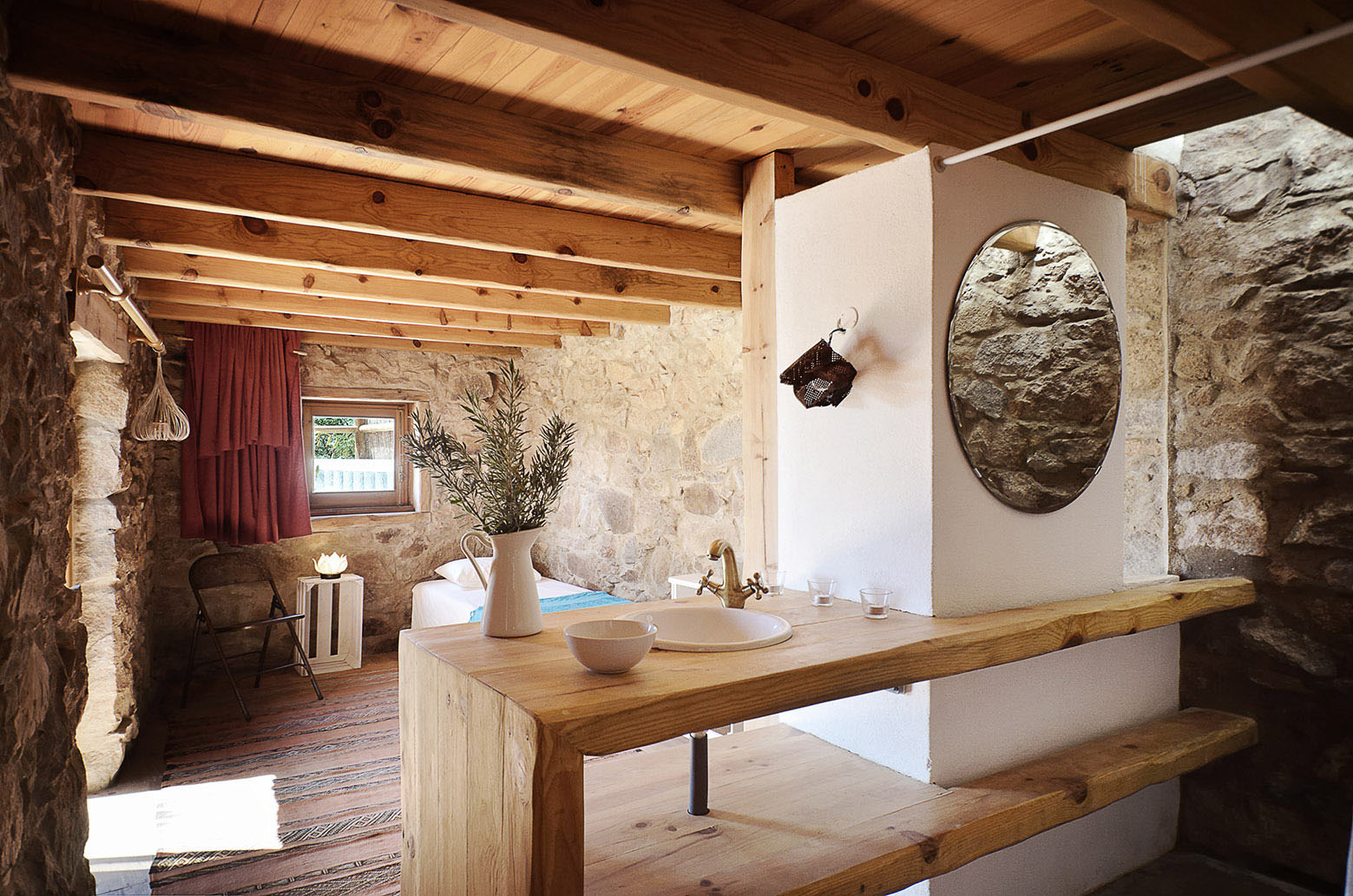 Rustic Bedroom with Stone Walls
