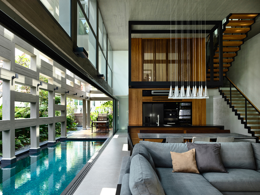 Indoor Outdoor Courtyard Swimming Pool Runs Deep Into A