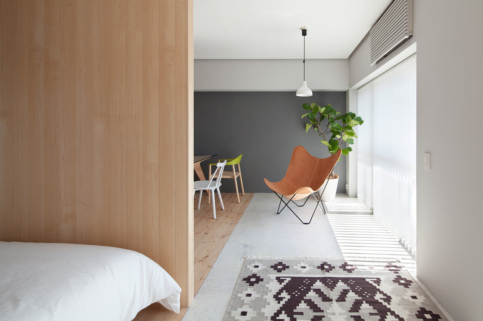 L Shaped Wood Partition Unifies All Areas In Small
