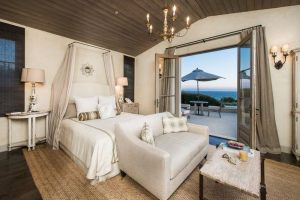 Mediterranean style bedroom with ocean view