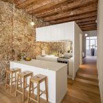 Newly Renovated Minimalist Apartment With Stone Wall And Wooden Beams