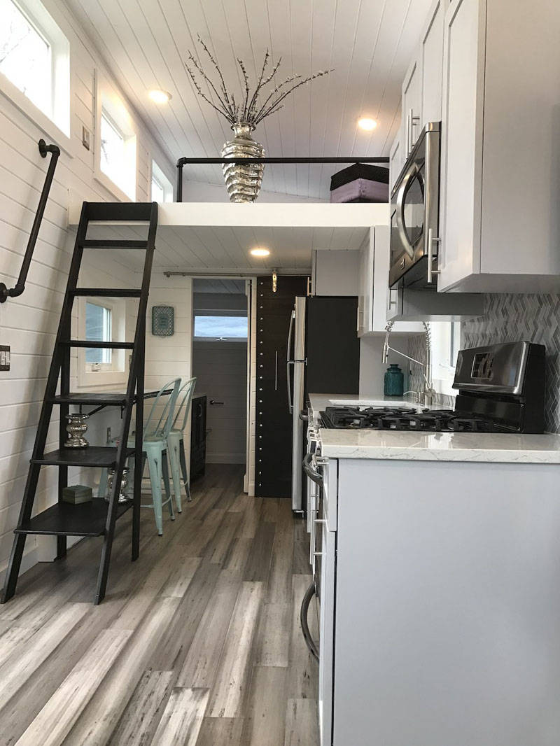 This Tiny Luxury Mobile Home Lets You Live Simply In Comfort ... High End Mobile Homes Interiors on high-end office furniture, beautiful trailer homes, high-end boats, high-end travel trailers, high-end condos, high-end tents, high-end airstream trailers, modular homes, high-end cars, high-end sheds, modern homes,