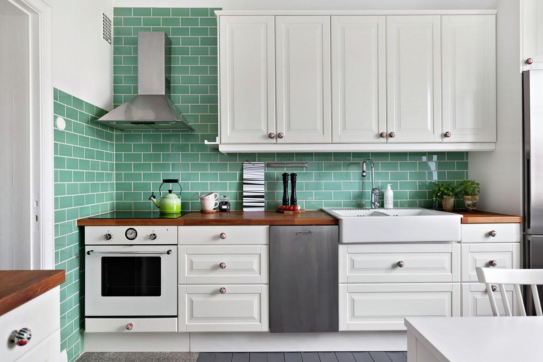 White IKEA Kitchen with Green Tiles
