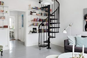 White Living Room with Black Spiral Staircase