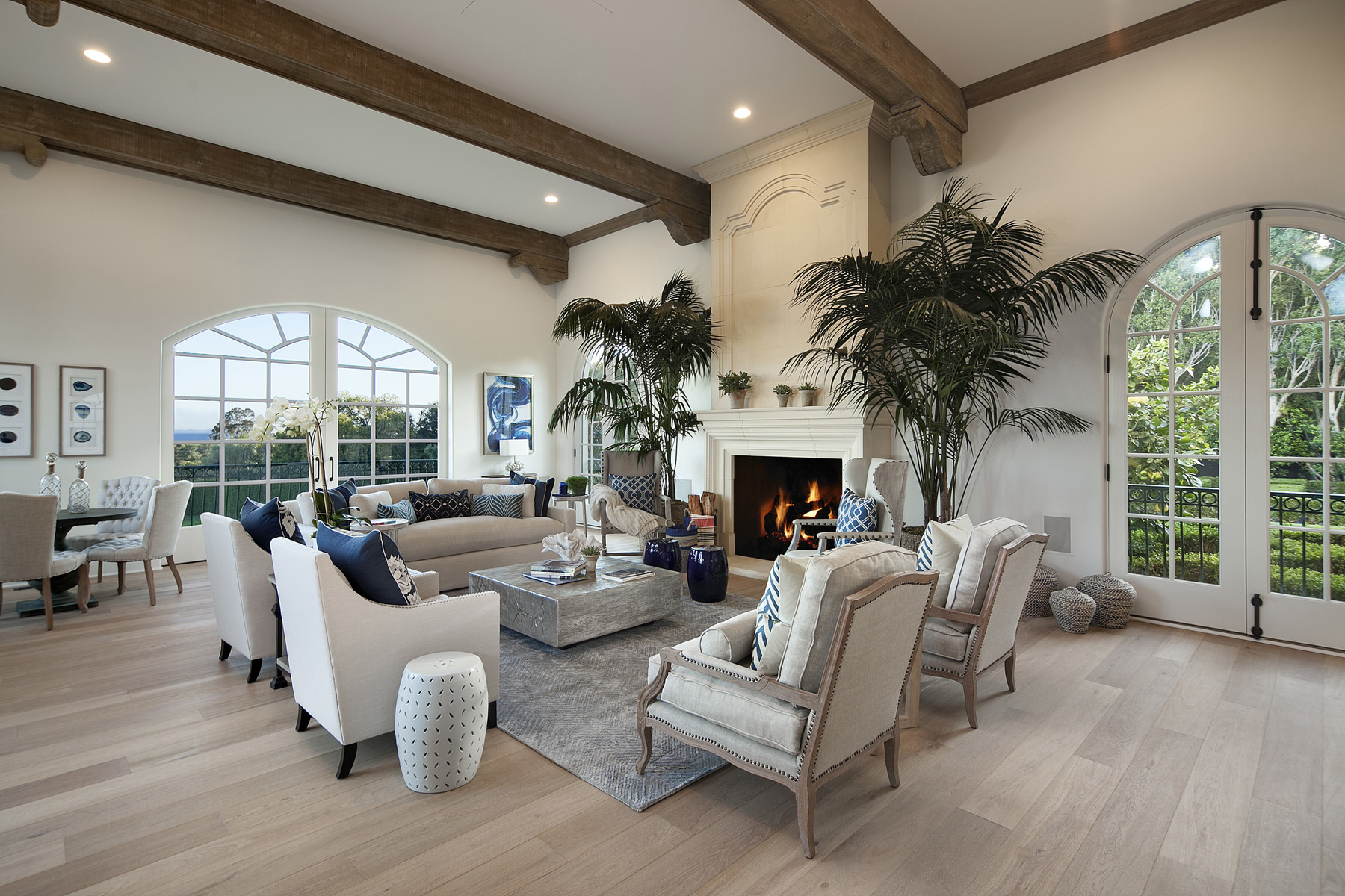 Elegant Living Room with Large Stone Fireplace and Ocean View