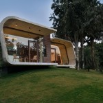 Minimalist Concrete Shell Pool House Overlooks Lush Landscape