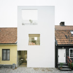 Minimalist Townhouse Between Old Buildings