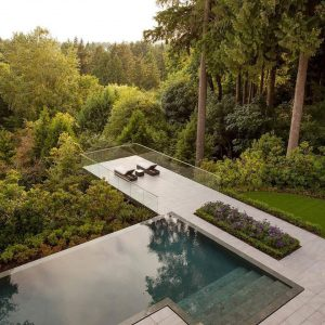 Modern Cantilevered Deck next to Infinity Pool