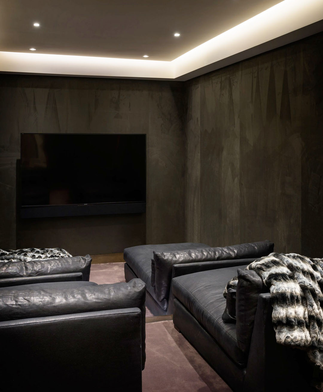 Home Theater with Black Leather Sofas
