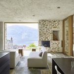 Modern Stone House with Terraced Garden Overlooking Lake Maggiore in Switzerland