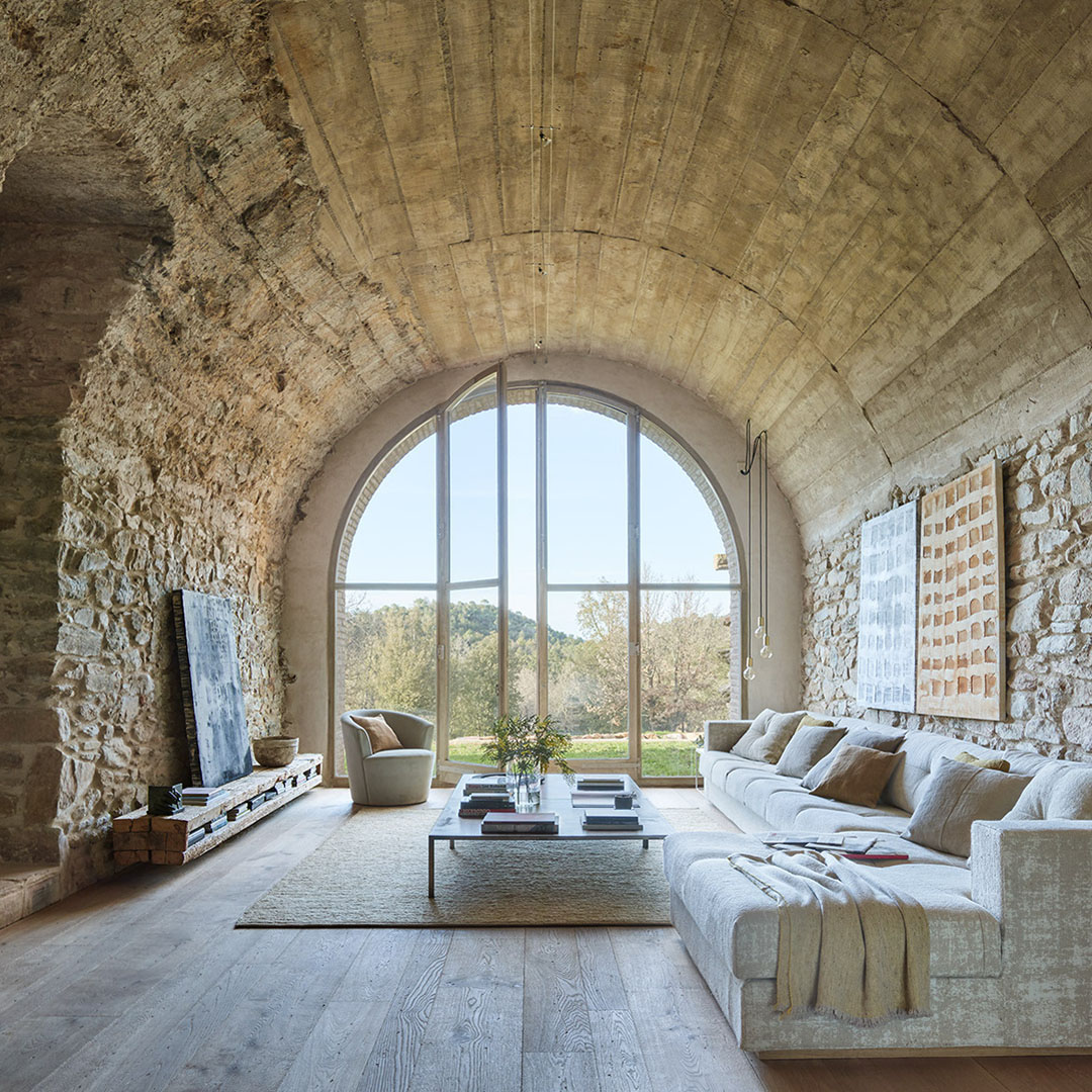 Stone House Interior with Arch Roof and Windows