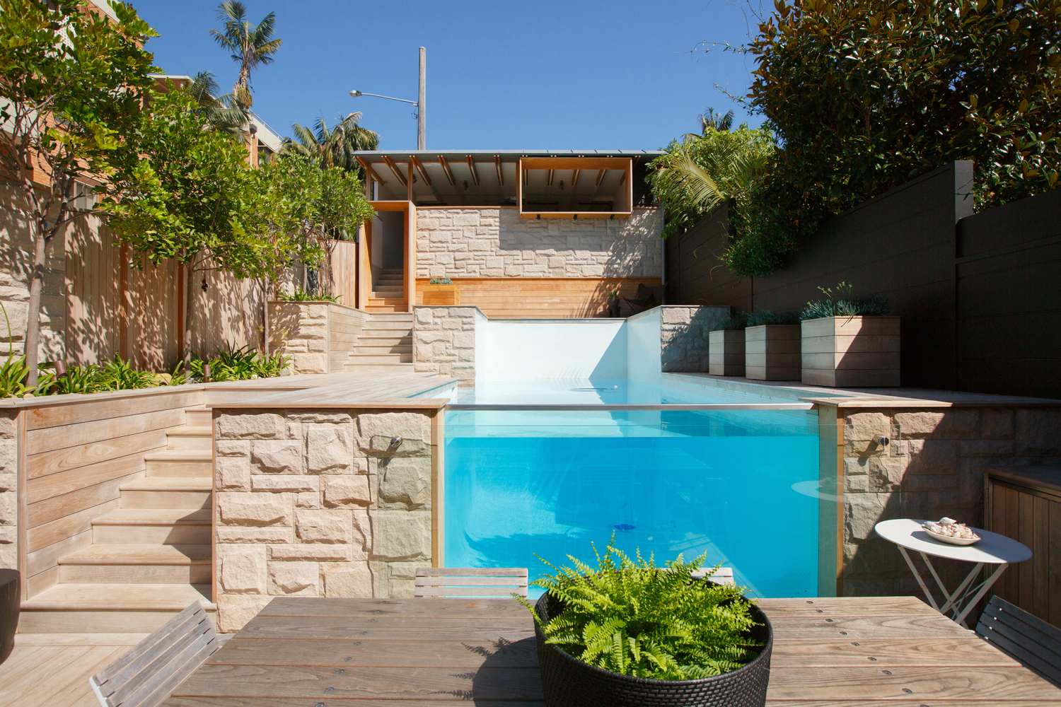House with Transparent Backyard Swimming Pool