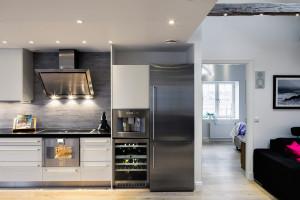 Modern White Kitchen with Stainless Steel Appliances