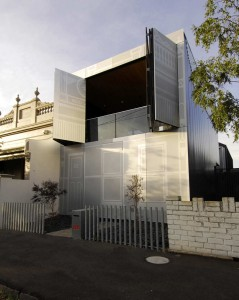 House with perforated steel screens