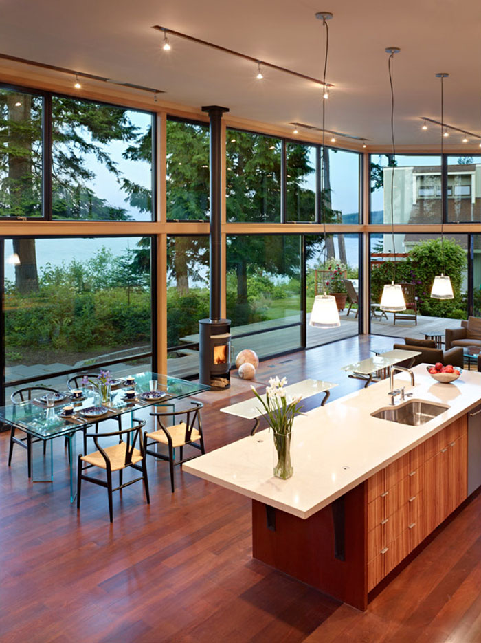 Modern Open Kitchen with High Ceiling and Water Views