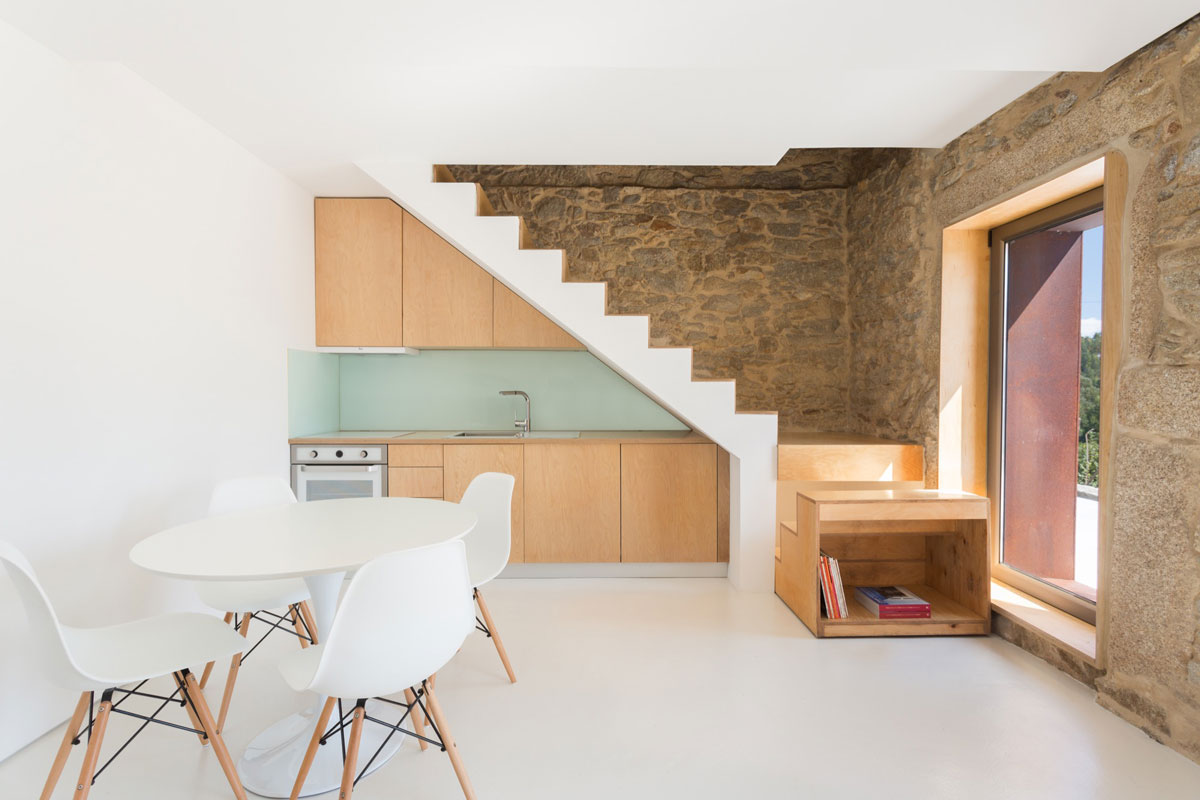 Restored historical stone building transformed into modern country house