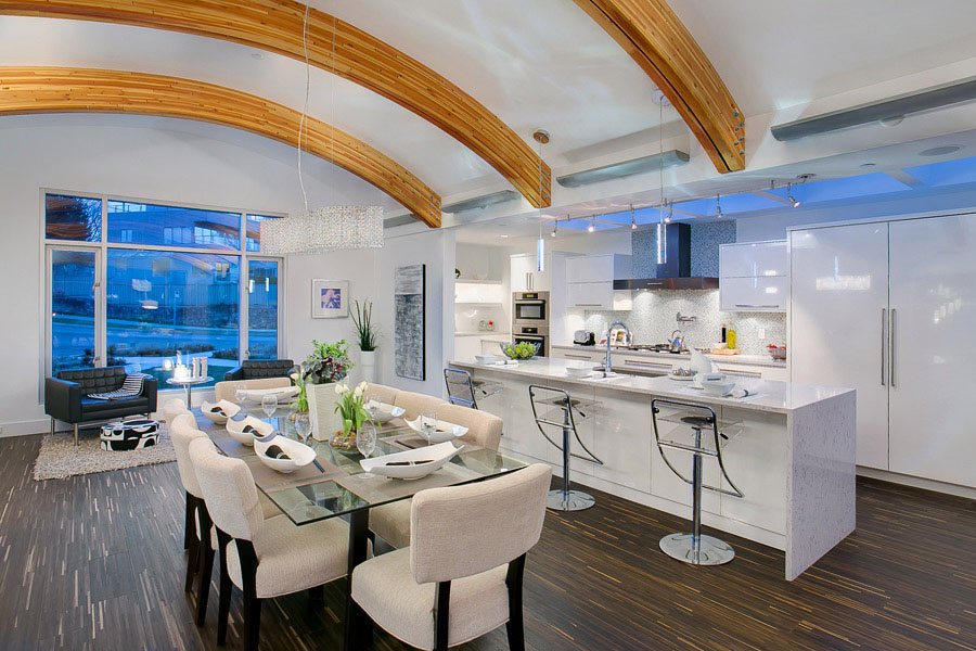 Contemporary Kitchen with Arced Ceiling Wood Beams
