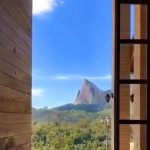 Giant Door at the Rancho Paraíso Azul Opens to Stunning Views of the Blue Stone