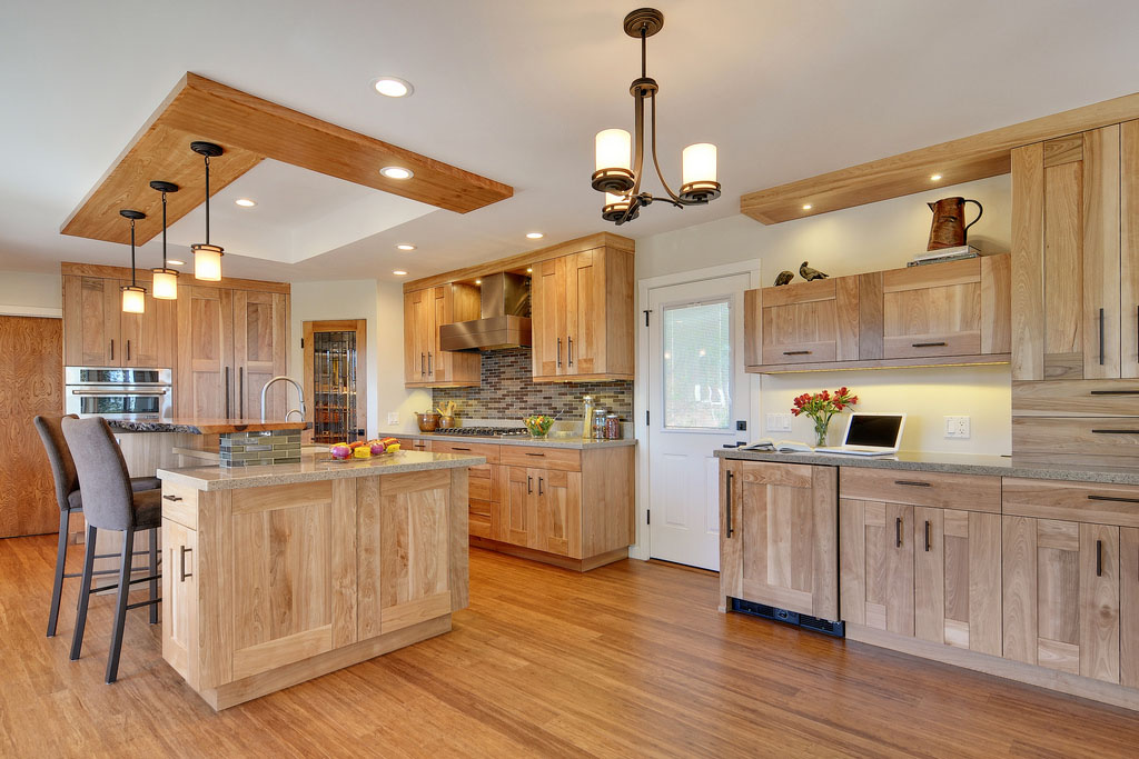Kitchen with Quartz Countertops and Light Natural Wood