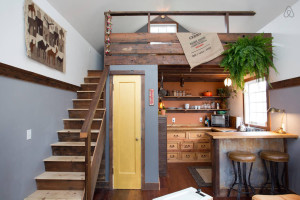 Charming Tiny House with Wood Flooring and Stairs