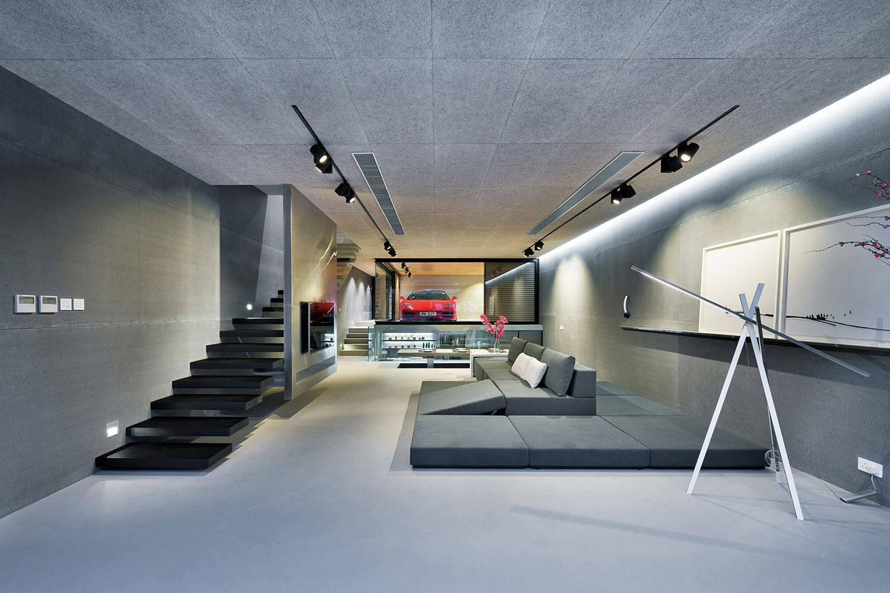 An ultra modern house in hong kong with a glass walled garage
