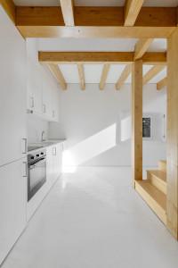 White Minimalist Kitchen with Wood Beams