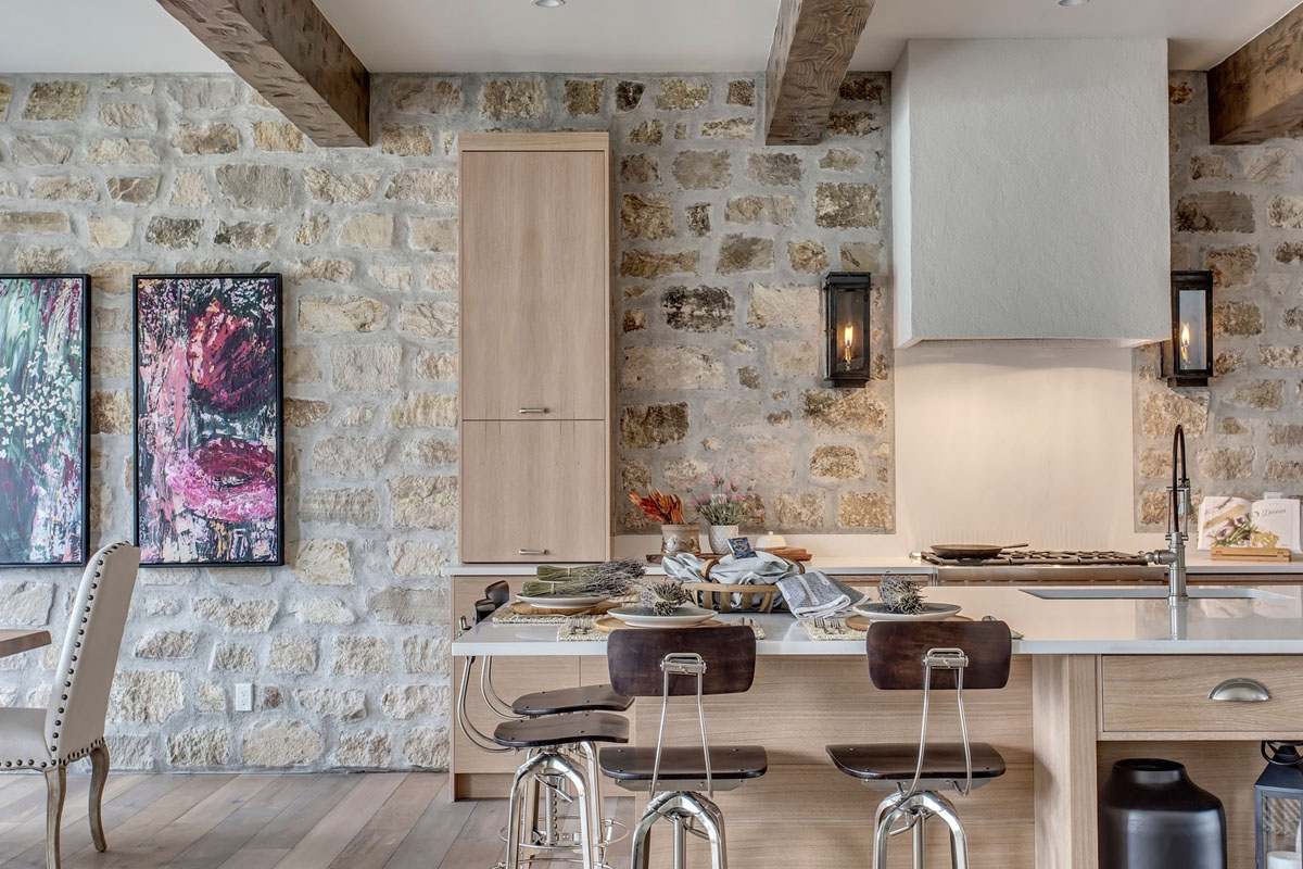 Elegant Modern Kitchen with Rustic Stone Walls and Ceiling Wood Beams