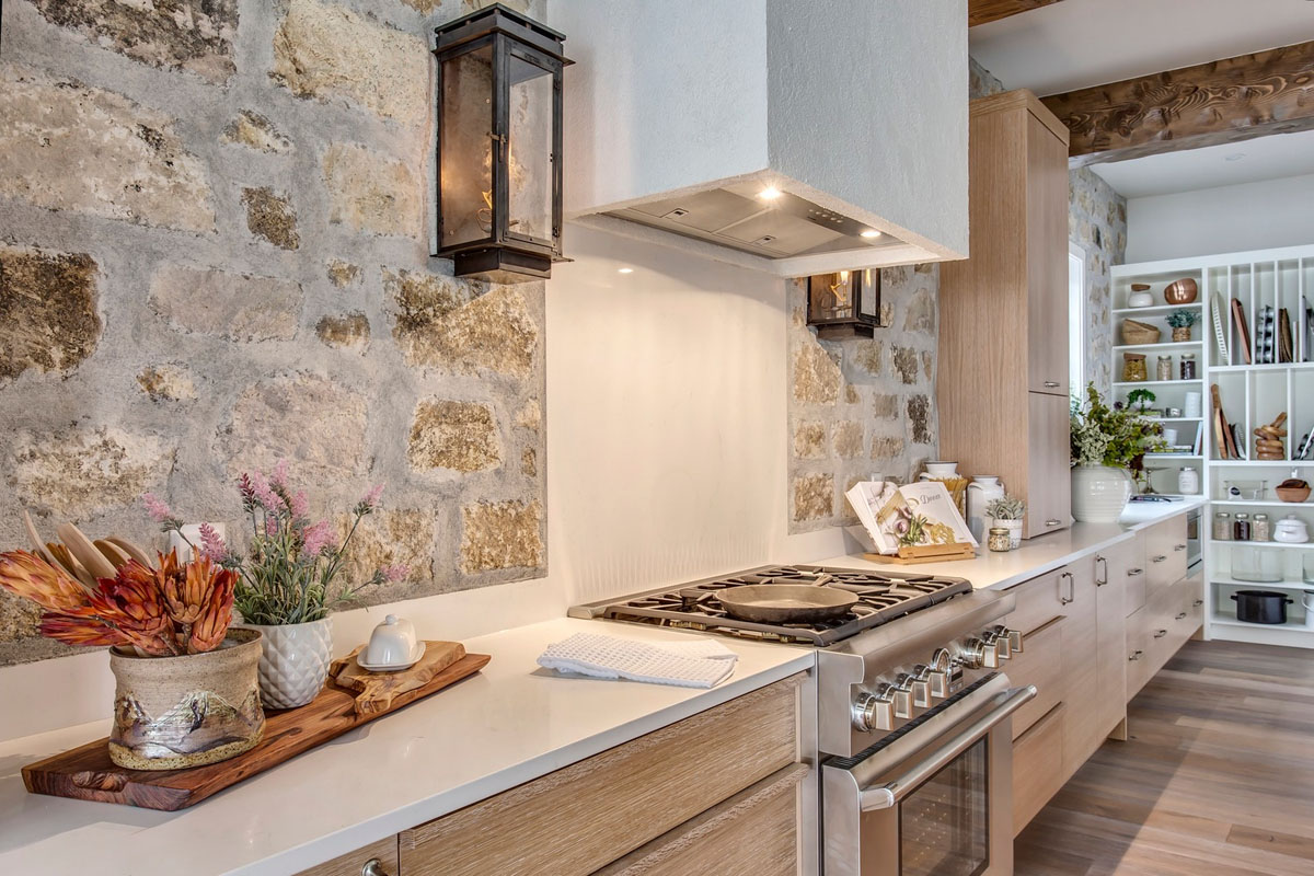 Rustic Modern Kitchen with Stone Walls and Quartz Countertops