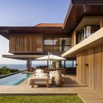 Coastal Home with Tropical Modern Architecture and Eclectic Interior Spaces