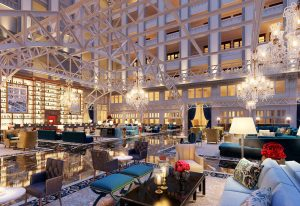 Grand Lobby elegantly finished with hand-woven area rugs,soaring brass fixtures and crystal chandeliers