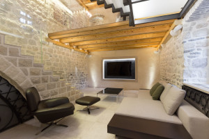 Entertainment Room with Stone Walls and Wood Beams