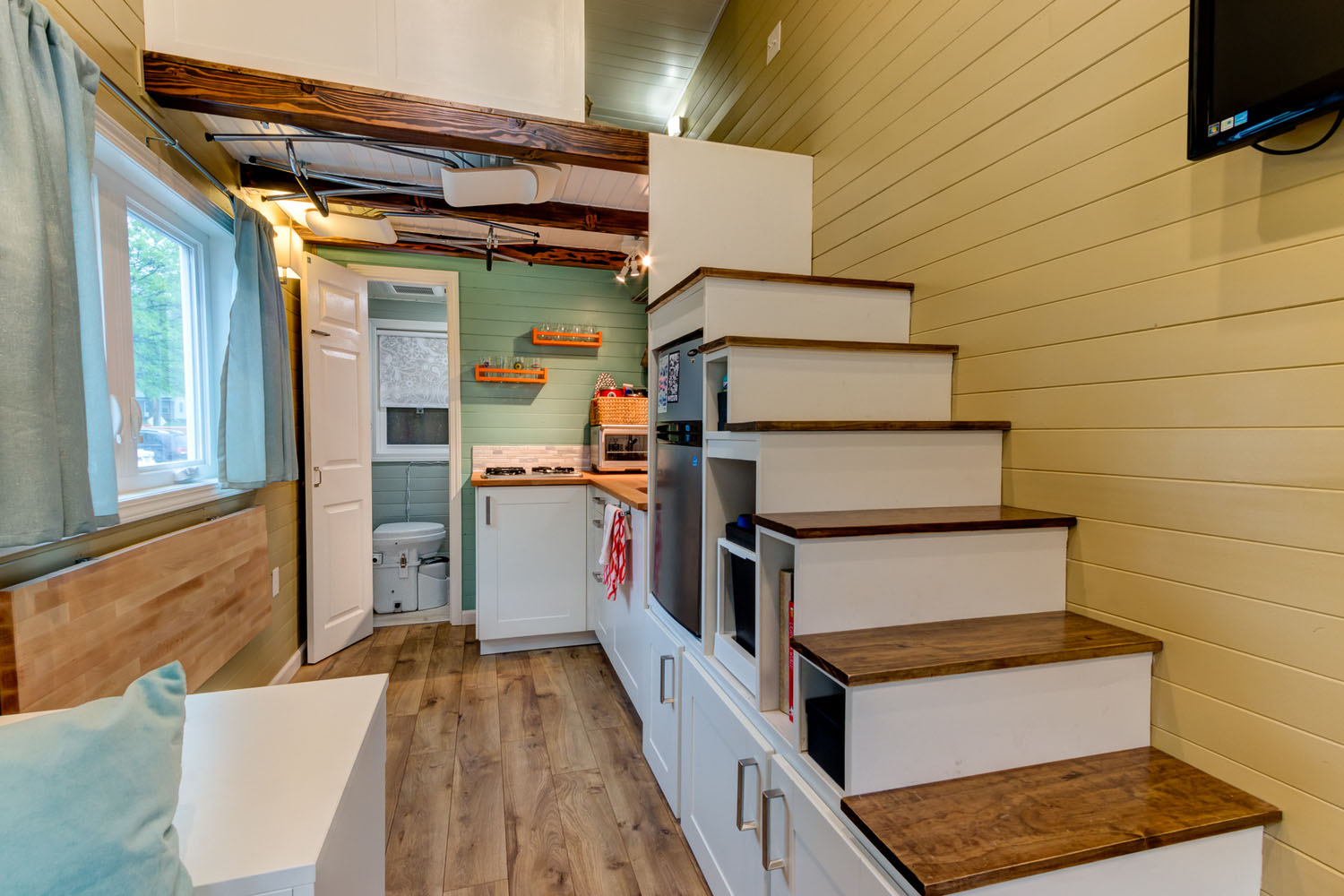 Tiny House Interior with Storage under the Staircase