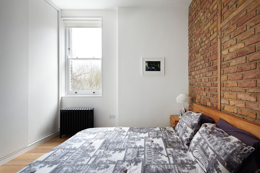 Bedroom with Brick Wall