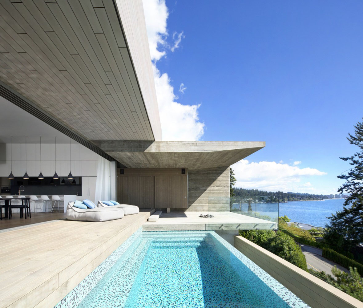Minimalist Concrete House With Intimate Interior Spaces And Dramatic Habour Views