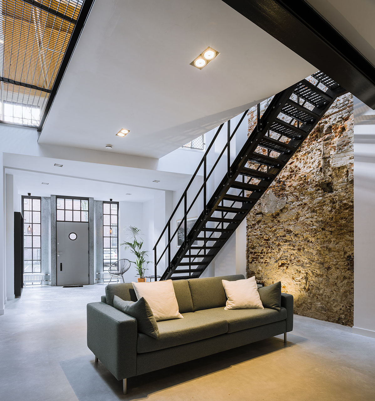 Elegant European Contemporary Loft with Stone Wall